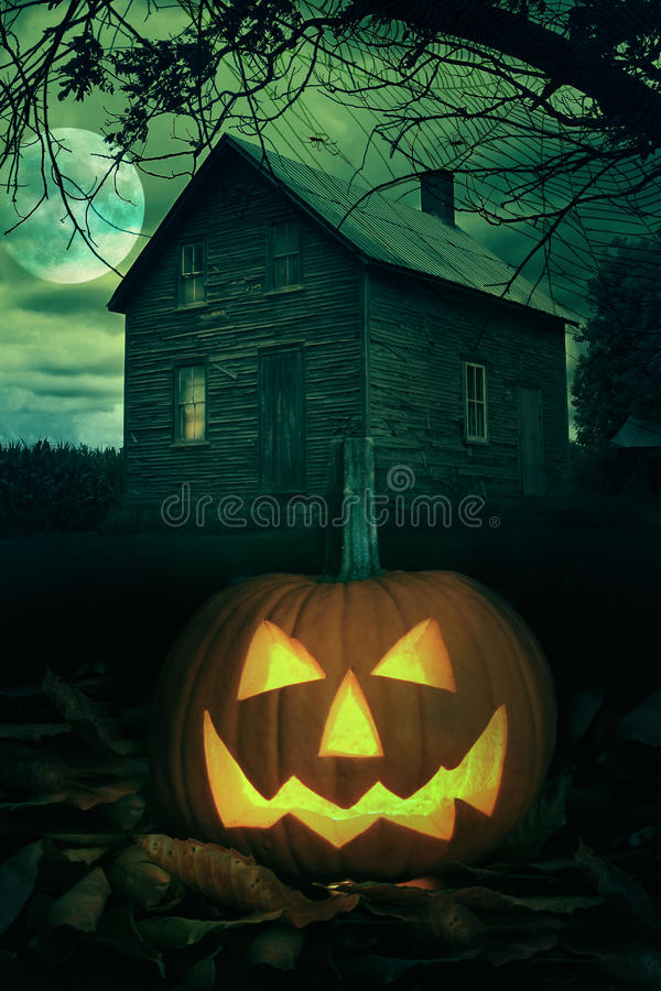 Download Halloween Pumpkin In Front Of A Spooky House Royalty Free Stock Images - Image: 26779809