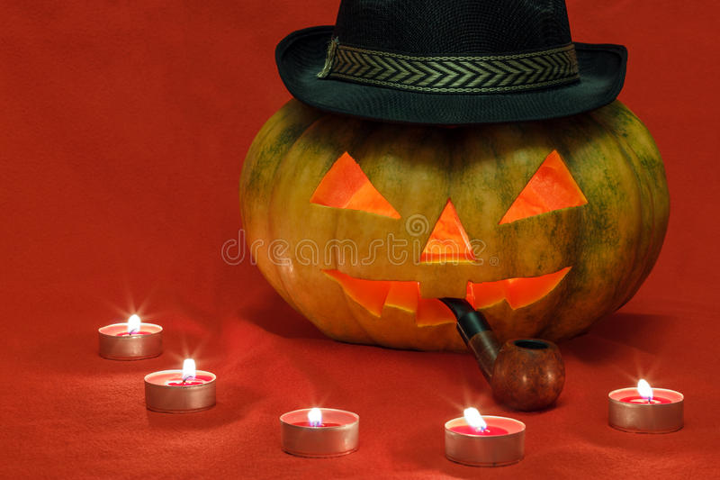 Halloween. Pumpkin with glowing eyes stock photo