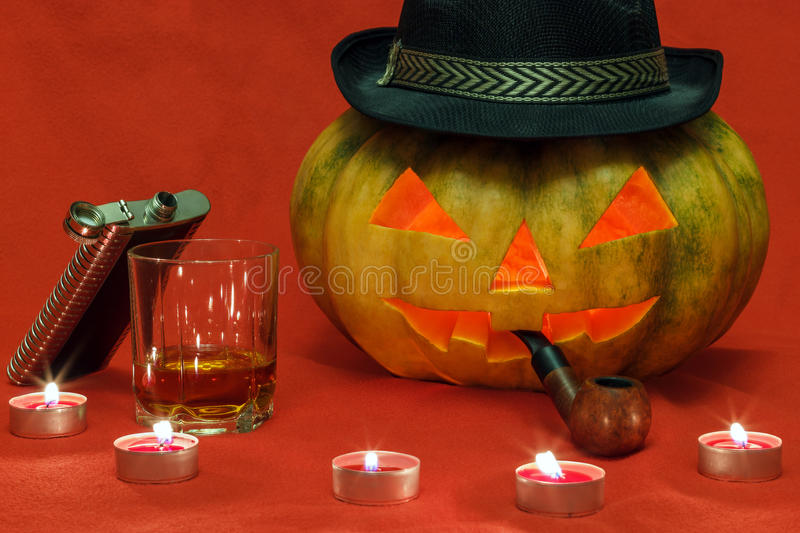 Halloween. Pumpkin with glowing eyes stock image