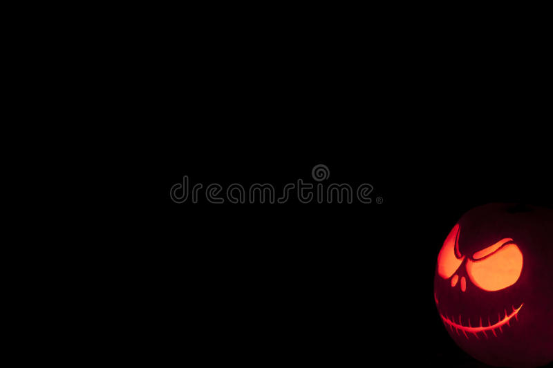 Halloween pumpkin grimming face angled royalty free stock images
