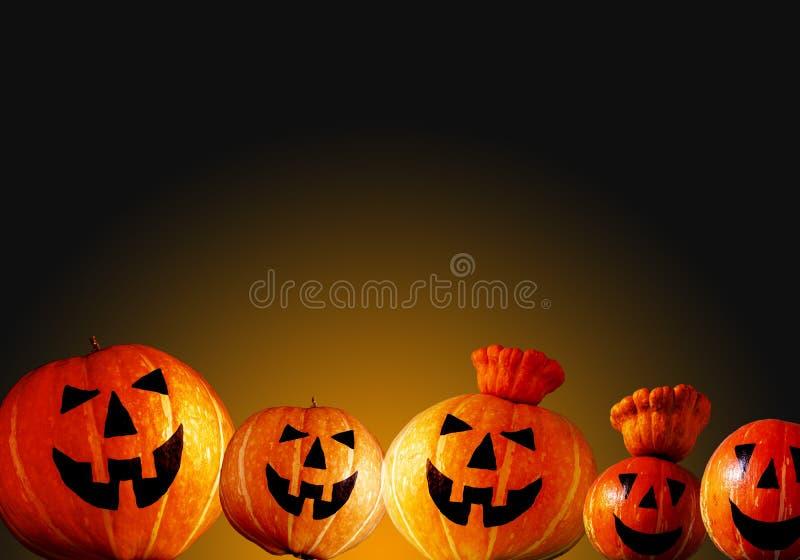 Halloween pumpkin head jack on dark- orange background stock photos