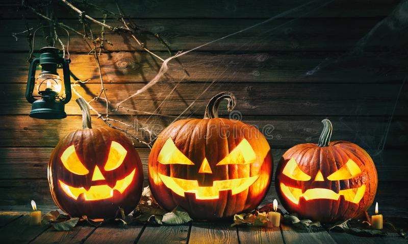 Halloween pumpkin head jack lantern with burning candles royalty free stock photo