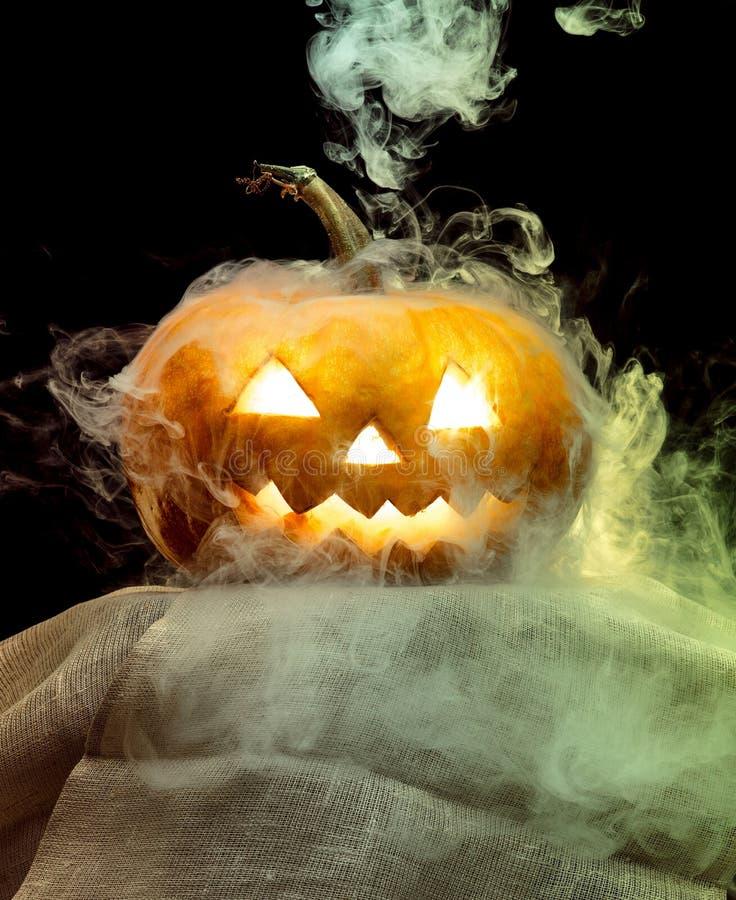 Halloween pumpkin head jack lantern with scary evil face. Halloween pumpkin head jack-o-lantern with scary evil face. Seasonal illuminated decoration. Looks royalty free stock photography