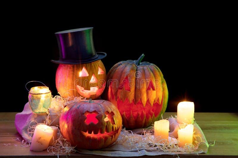 Halloween pumpkin head jack lantern with scary evil faces and candles. Halloween pumpkin head jack-o-lantern with scary evil faces and candles. Seasonal royalty free stock image