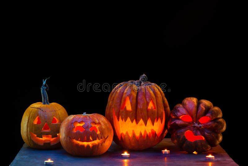Halloween pumpkin head jack lantern with scary evil faces and candles. Halloween pumpkin head jack-o-lantern with scary evil faces and candles. Seasonal stock image