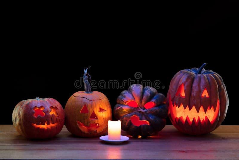 Halloween pumpkin head jack lantern with scary evil faces and candles. Halloween pumpkin head jack-o-lantern with scary evil faces and candles. Seasonal stock photos