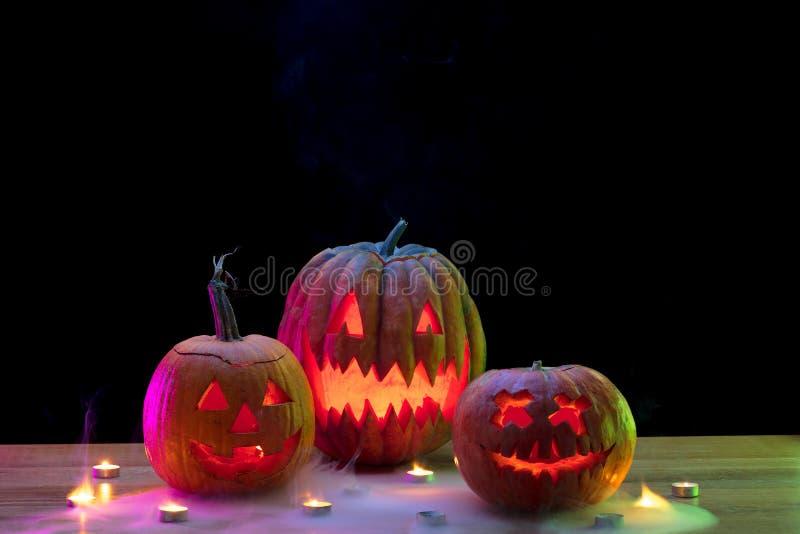 Halloween pumpkin head jack lantern with scary evil faces and candles. Halloween pumpkin head jack-o-lantern with scary evil faces and candles. Seasonal royalty free stock photos