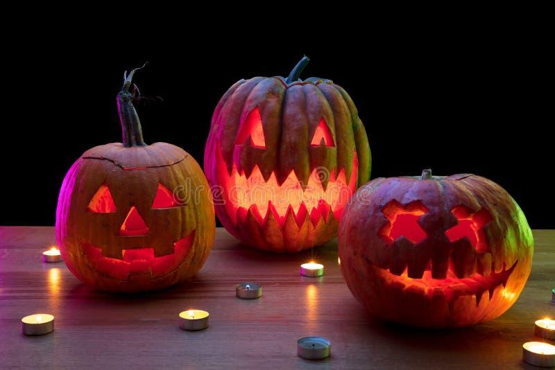Halloween pumpkin head jack lantern with scary evil faces and candles. Halloween pumpkin head jack-o-lantern with scary evil faces and candles. Seasonal royalty free stock photo