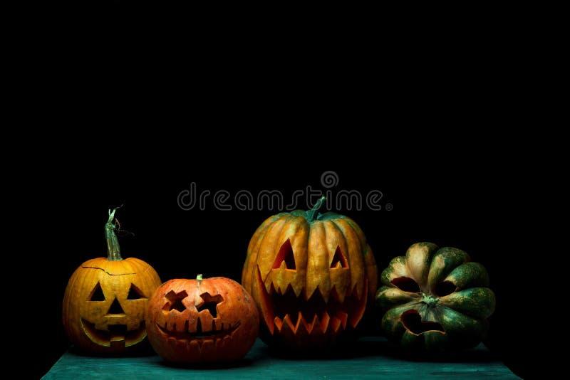 Halloween pumpkin head jack lantern with scary evil faces. Halloween pumpkin head jack-o-lantern with scary evil faces. Bad friends. Seasonal illuminated royalty free stock photo