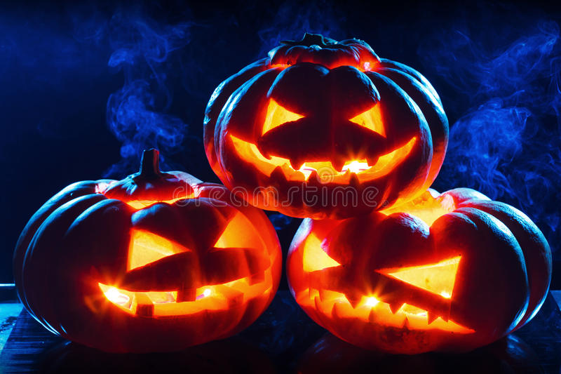 Halloween pumpkin head jack lantern. With scary evil faces spooky holiday stock photos