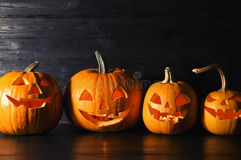 Halloween pumpkin head jack lanterns on table stock photos