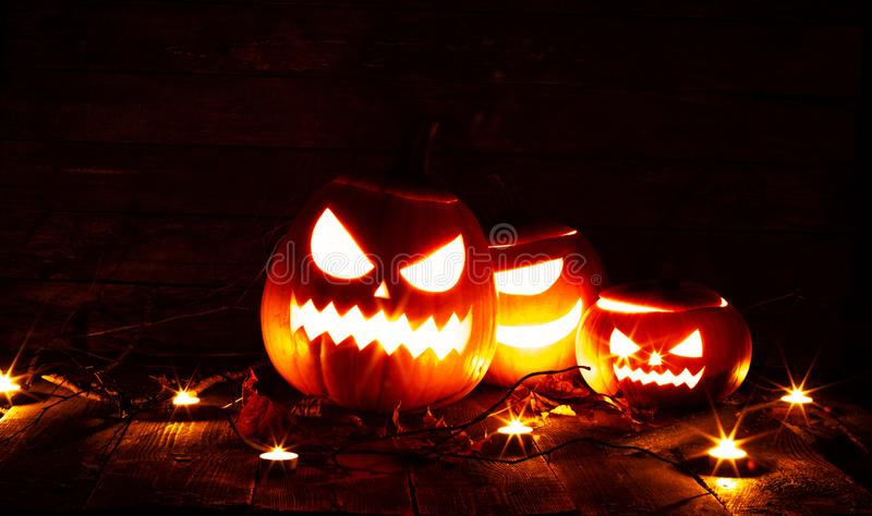 Halloween pumpkin and candles stock images