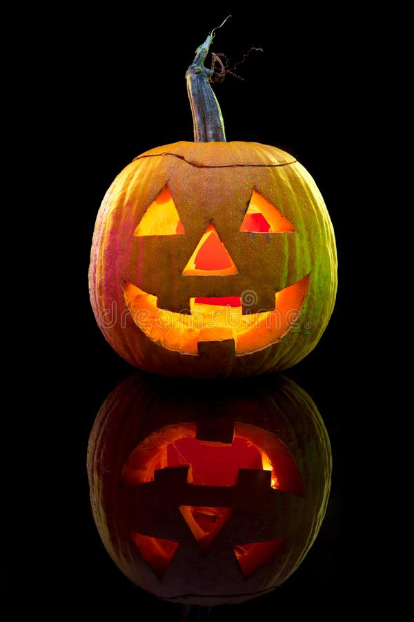 Halloween pumpkin head jack lantern with scary evil face. Halloween pumpkin head jack-o-lantern with scary evil face. Seasonal illuminated decoration. Looks royalty free stock image