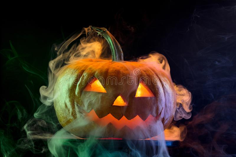Halloween pumpkin head jack lantern with scary evil face. Halloween pumpkin head jack-o-lantern with scary evil face. Seasonal illuminated decoration. Looks royalty free stock images