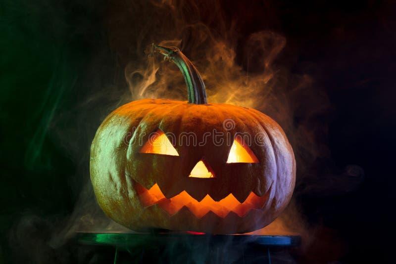 Halloween pumpkin head jack lantern with scary evil face. Halloween pumpkin head jack-o-lantern with scary evil face. Seasonal illuminated decoration. Looks royalty free stock photo