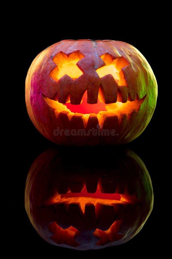 Halloween pumpkin head jack lantern with scary evil face. Halloween pumpkin head jack-o-lantern with scary evil face. Seasonal illuminated decoration. Looks stock photography