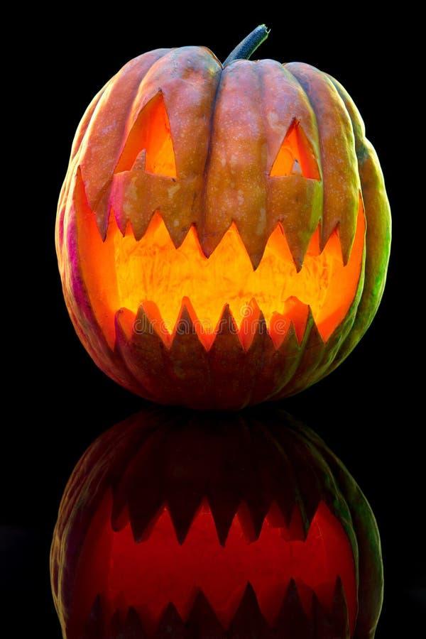 Halloween pumpkin head jack lantern with scary evil face. Halloween pumpkin head jack-o-lantern with scary evil face. Seasonal illuminated decoration. Looks stock image