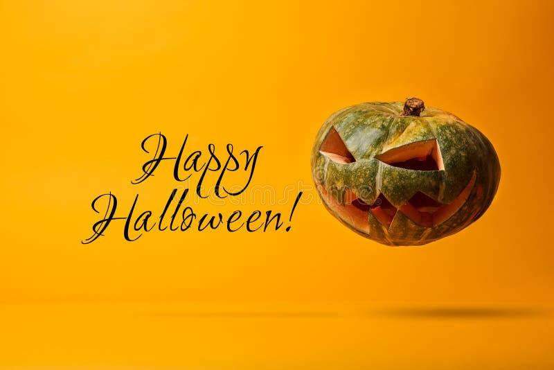Halloween pumpkin and inscription on blank orange background. stock images
