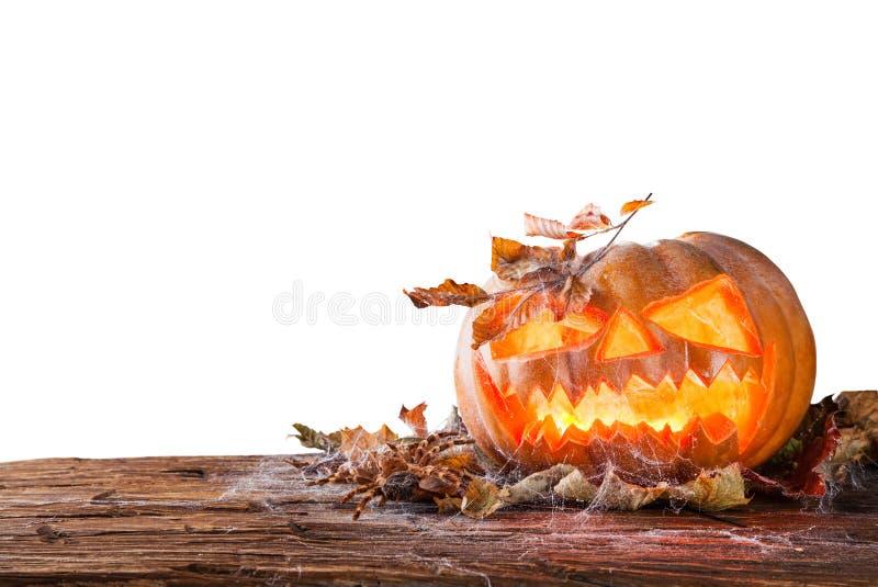 Halloween pumpkin isolated on white background. Spooky halloween pumpkin on wooden planks, isolated on white background royalty free stock photos