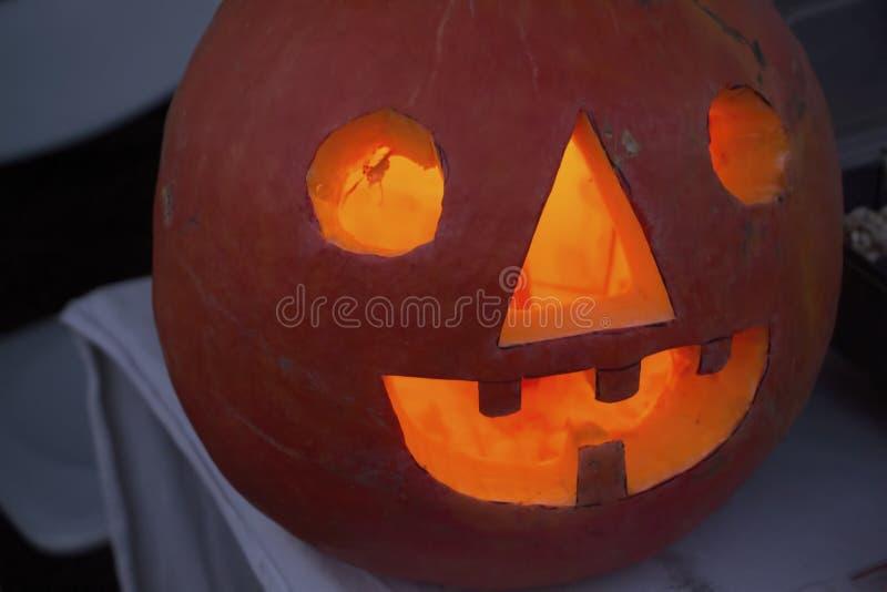 Halloween pumpkin lantern. Shiny Halloween pumpkin lantern on the table stock photos