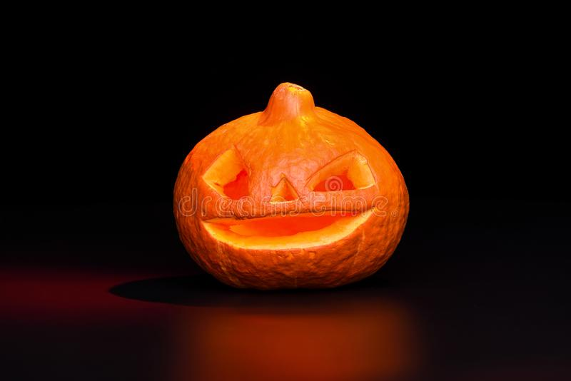 Halloween pumpkin lantern over black background with red backlight stock images