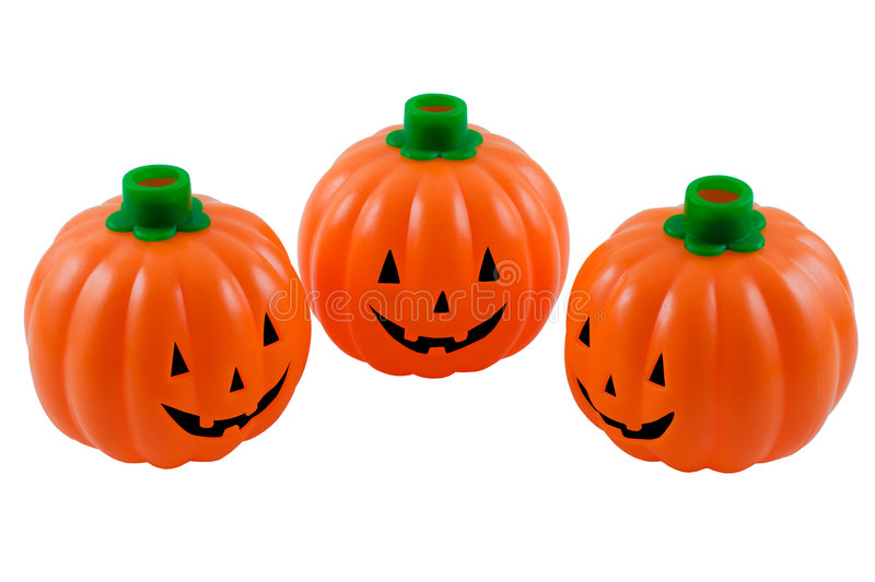 Halloween pumpkin lanterns. Three smiling Halloween pumpkin lanterns, isolated on a white background with clipping path royalty free stock image