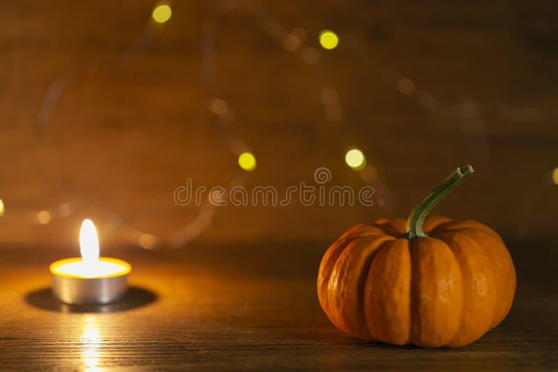 Halloween pumpkin on old wooden background. Warm lights behind stock photos