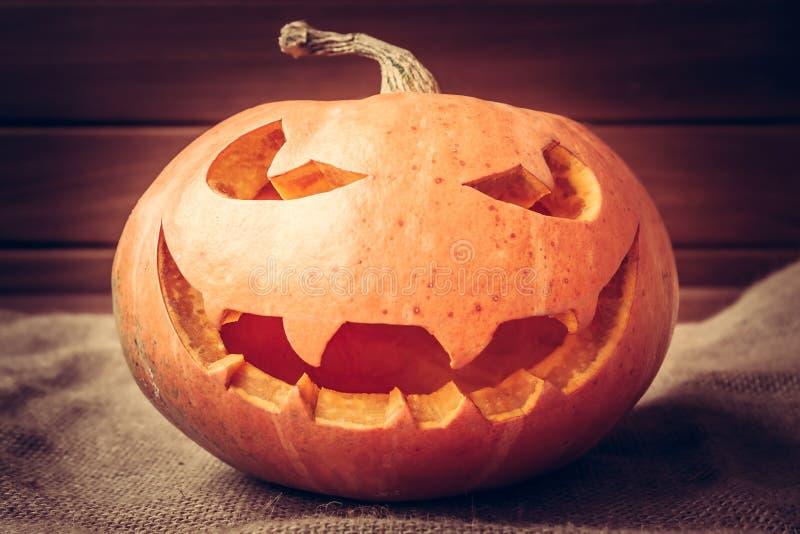 Halloween pumpkin portrait on dark background. Spooky halloween pumpkin portrait on dark background stock image
