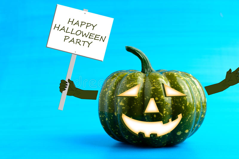 Halloween pumpkin with a poster in his hand. On a blue background stock photography