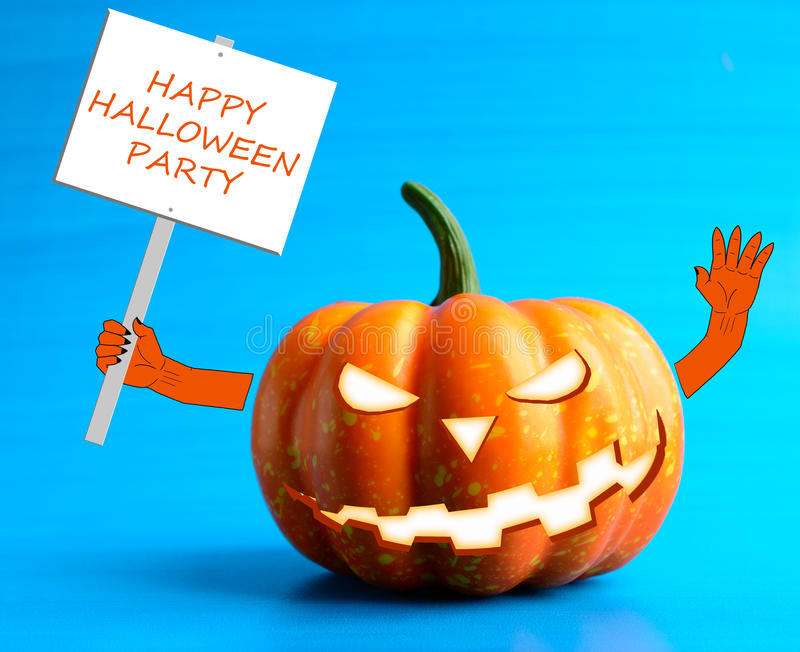 Halloween pumpkin with a poster in his hand. On a blue background stock images