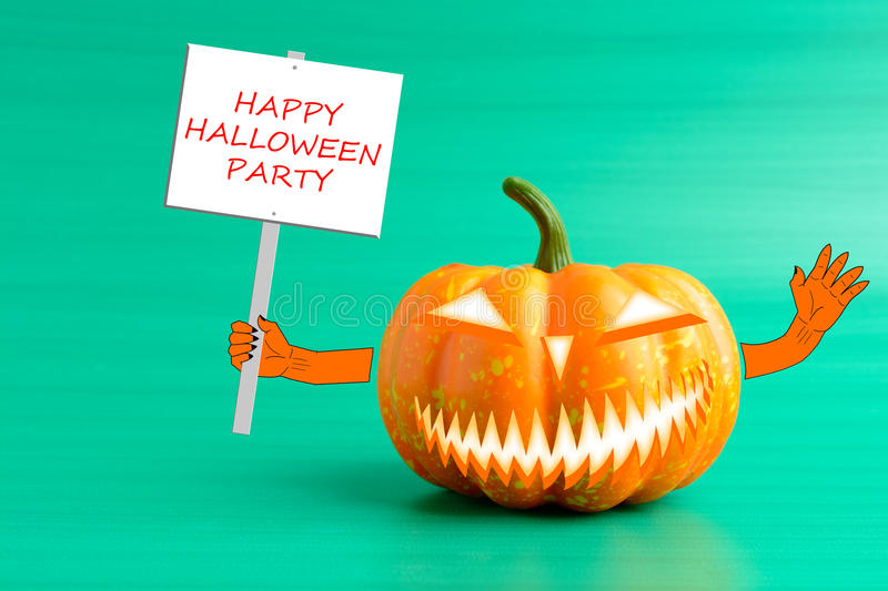 Halloween pumpkin with a poster in his hand. On a turquoise background stock image