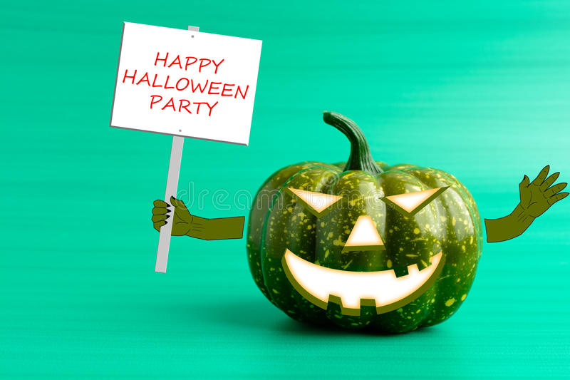 Halloween pumpkin with a poster in his hand. On a turquoise background stock photography
