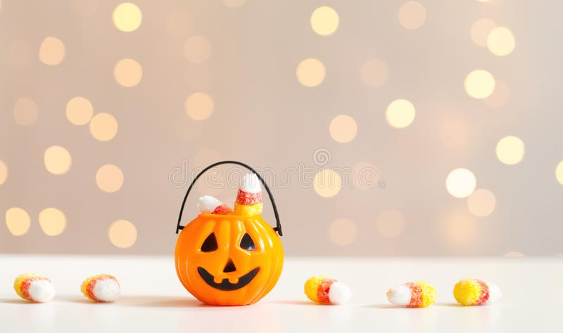 Halloween pumpkin with shiny lights. Halloween pumpkin on a shiny light background royalty free stock photos