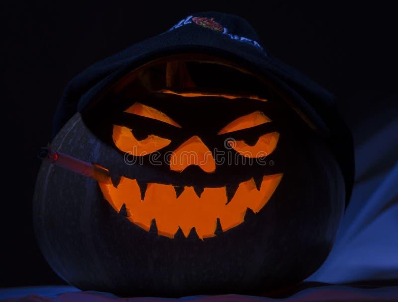 Halloween pumpkin smoking cigarette stock images