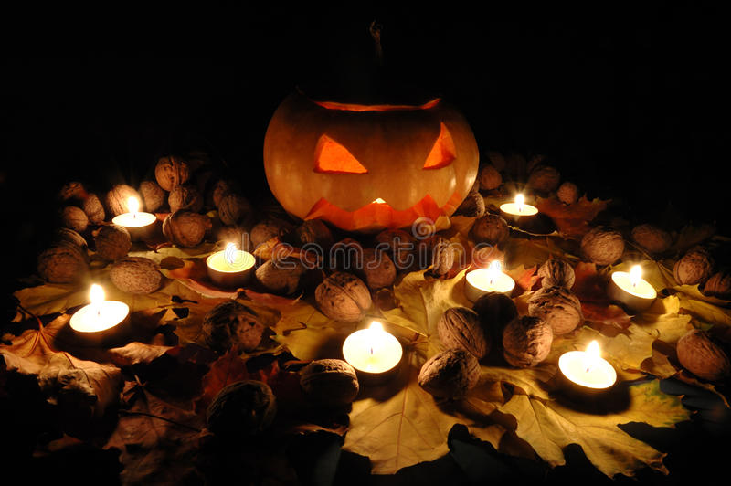 Halloween pumpkin still life with candles royalty free stock image