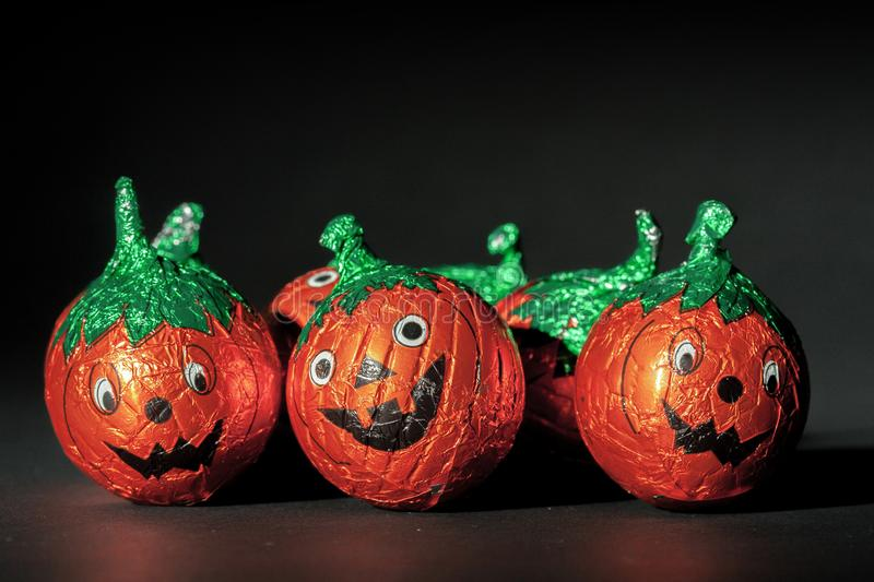 Halloween pumpkin sweets with scary faces stock image