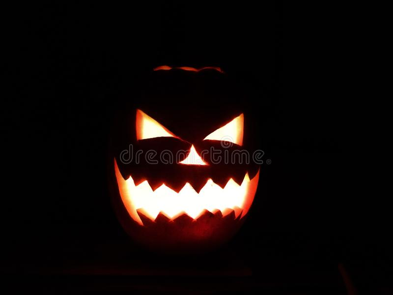 Halloween pumpkin. The terrible face of Jack O`Lantern in the dark royalty free stock image