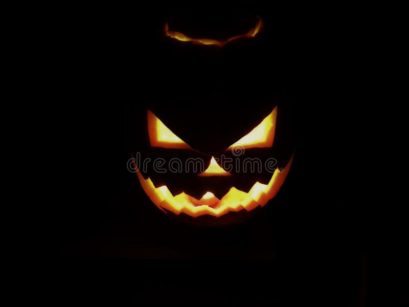 Halloween pumpkin. The terrible face of Jack O`Lantern in the dark royalty free stock photo