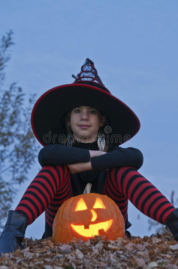 Halloween pumpkin with witch sitting royalty free stock photos