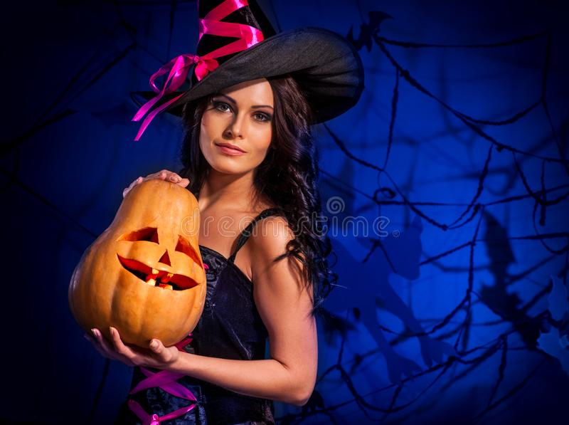 Halloween pumpkin in witch woman hands. royalty free stock images