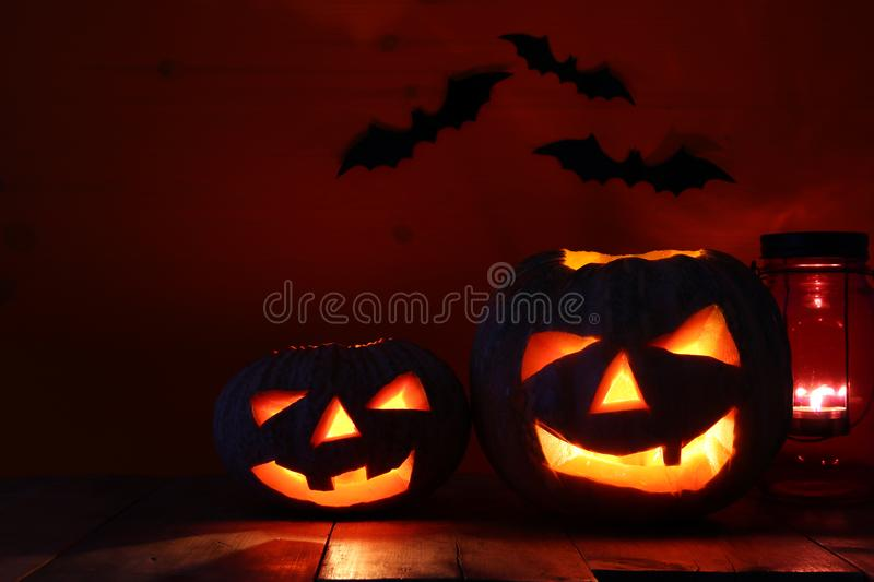 Halloween Pumpkin on wooden table in front of spooky dark background. Jack o lantern.  royalty free stock image