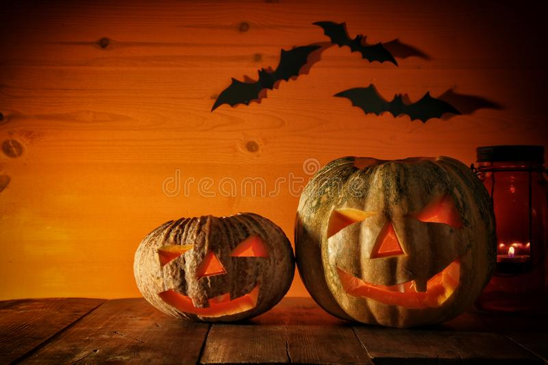 Halloween Pumpkin on wooden table in front of spooky dark background. Jack o lantern stock photography