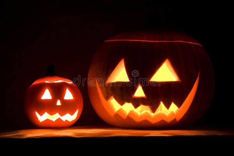 Halloween pumpkins. Illuminated halloween pumpkins by night stock photo