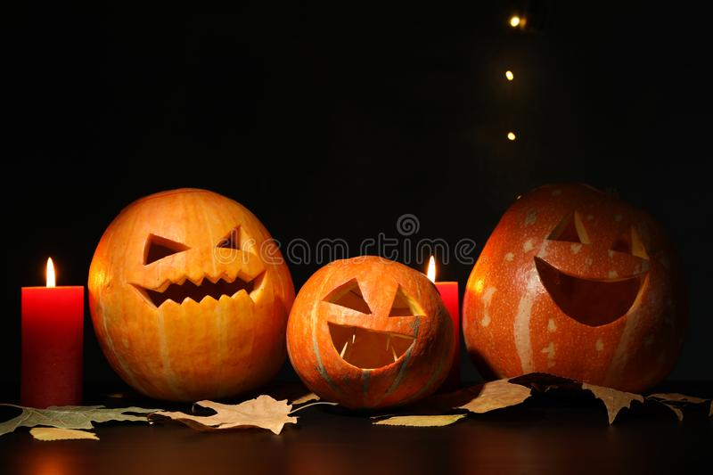 Halloween pumpkins and candles on dark background royalty free stock photos