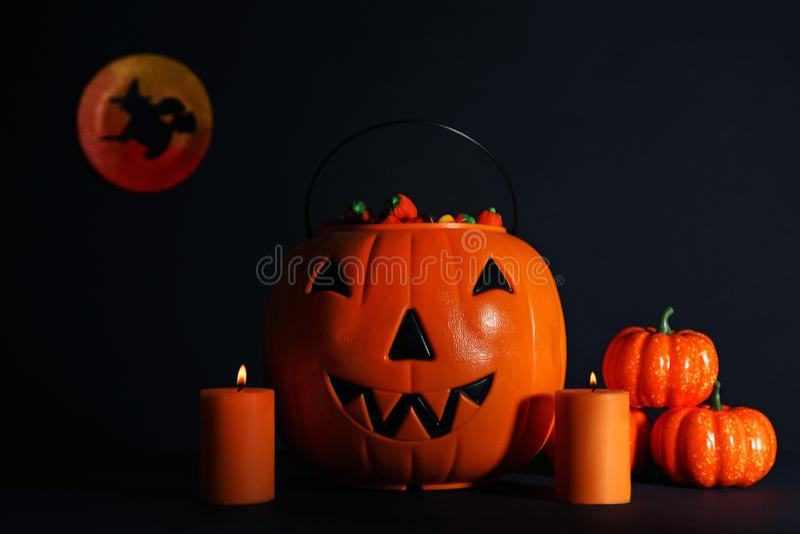 Halloween pumpkins with candy corns royalty free stock photos