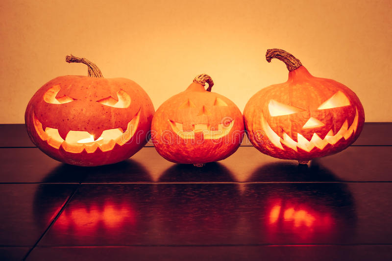 Halloween pumpkins family portrait with shining smile in vibrant orange colors stock images