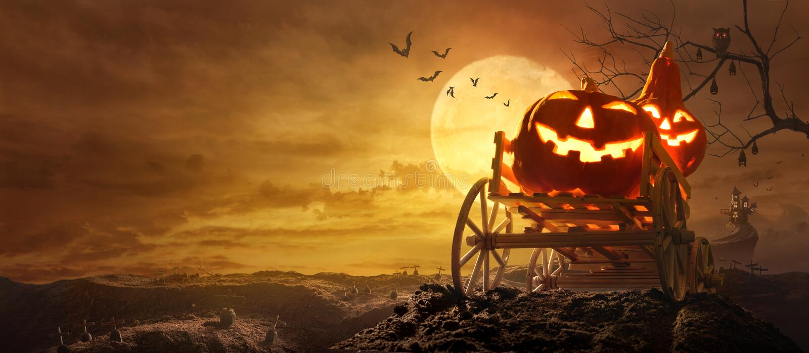 Halloween pumpkins on farm wagon going through Stretched road gr royalty free stock photo