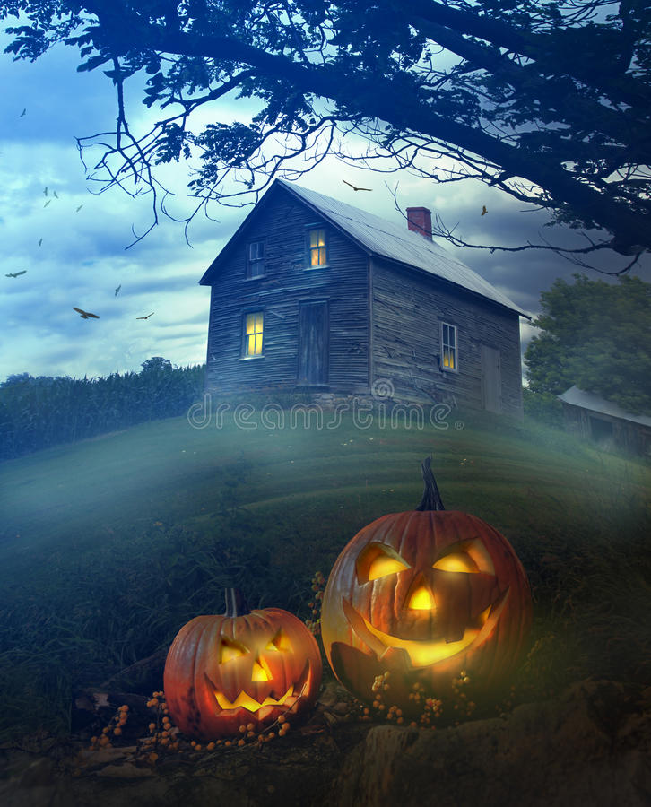 Halloween pumpkins in front of Spooky house. Halloween pumpkins in front of a Spooky house stock photography