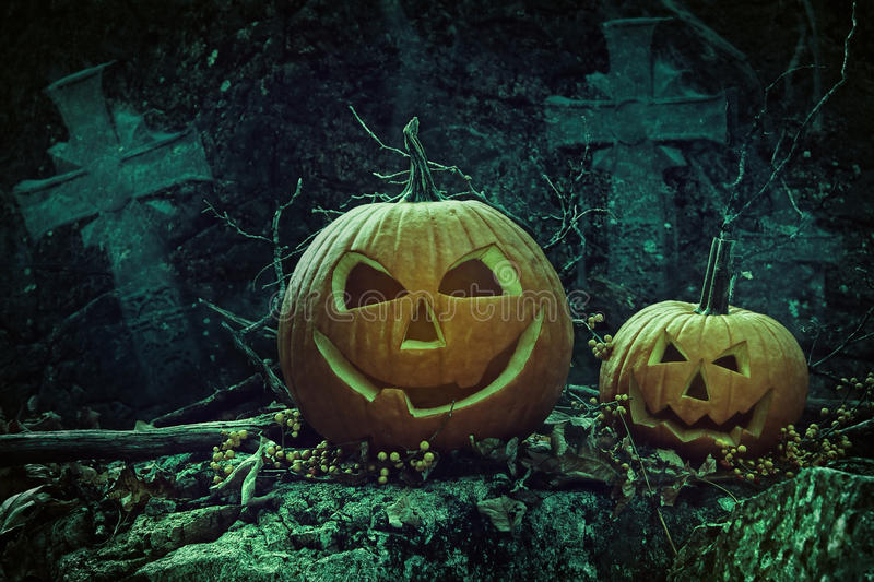 Download Halloween Pumpkins In Graveyard At Night Stock Photo - Image: 33552642