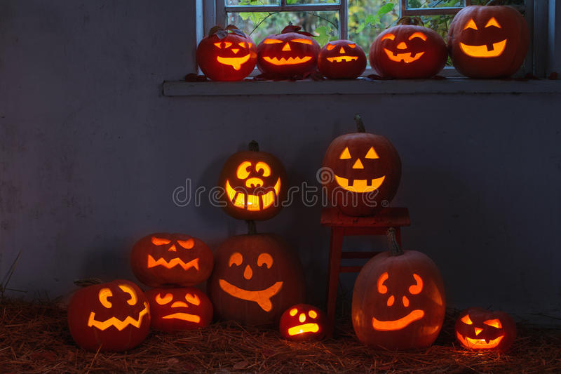 Halloween pumpkins indoor. The halloween pumpkins in night royalty free stock photography